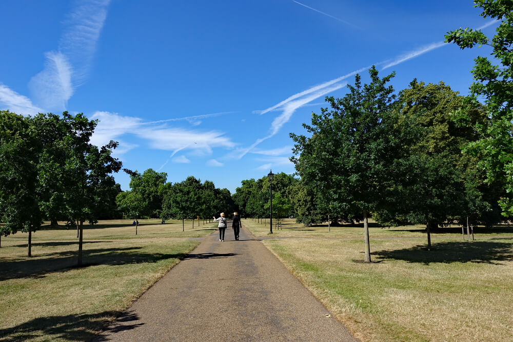 couple strolling in hyde park london